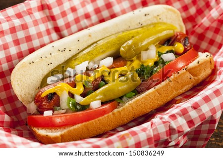 Chicago Style Hot Dog with Mustard, Pickle, Tomato, Relish and Onion - stock photo