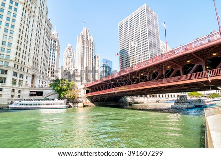CHICAGO, UNITED STATES - AUGUST 15, 2014: Michigan Avenue Bridge - DuSable Bridge, is a bascule bridge that carries Michigan Avenue across the main stem of the Chicago River in downtown Chicago.  - stock photo