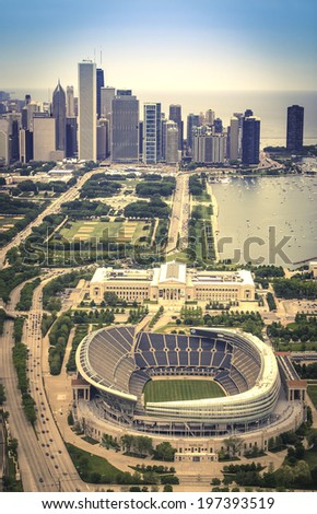 CHICAGO - UNITED STATES - JUNE 7, 2014: Empty Soldiers Filed Stadium against city of Chicago skyline, aerial view - stock photo