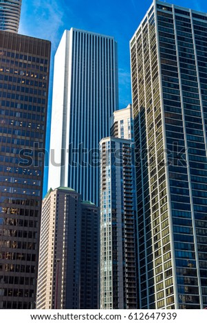 Chicago, US - July 19, 2016: Corporate buildings and skyscrapers in Chicago's Loop as seen from downtown near Chicago river