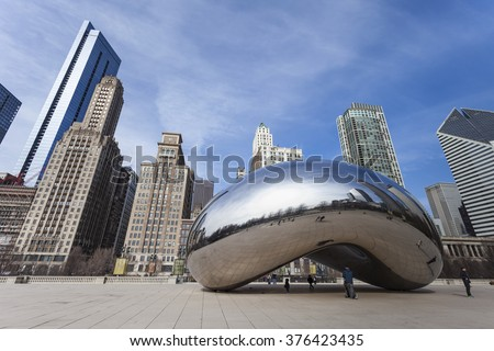 CHICAGO, USA - APRIL 02: Cloud Gate and Chicago skyline on April 02, 2014 in Chicago (USA) - stock photo