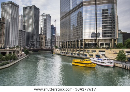 CHICAGO,USA-AUGUST 12,2013:Chicago skyline, looking west from Michigan Avenue bridge, view on Chicago River and water taxi in a daytime - stock photo