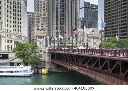 CHICAGO,USA-AUGUST 12,2013:Chicago skyline, looking west from Michigan Avenue bridge, view on Chicago and famous skyscrapers of chicago in a day time - stock photo