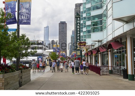 CHICAGO,USA-AUGUST 12,2013:people and tourists flock michigan avenue in chicago to see the city or attending the work.All lost in their own thoughts - stock photo