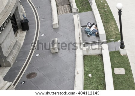 CHICAGO,USA-AUGUST 12,2013:two boys sleep in the streets on a summer morning in Chicago. - stock photo