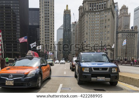 CHICAGO,USA-AUGUST 12,2013:view of Michigan avenue with traffic,people and skyline in the center of Chicago during a cloudy day. - stock photo