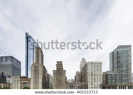 "CHICAGO,USA-AUGUST 12,2013:view of the skyline of Chicago from millenium park near the famous monument ""clouds gate"" - stock photo"