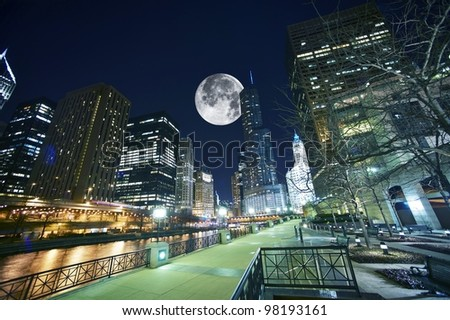 Chicago USA. Chicago at Night. Shot Taken from Chicago Famous Riverwalk. Large Moon on the Sky. - stock photo