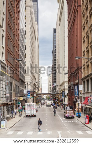 Chicago, USA - July 15, 2014: The highest building are located in financial district, which during week days is full of life.