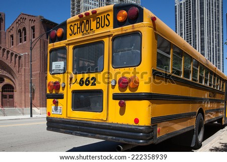CHICAGO,USA - JULY 12,2013 : Typical american yellow school bus before the D.L.Moody memorial church and sunday school in Chicago