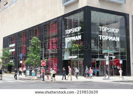 CHICAGO, USA - JUNE 26, 2013: People walk by Topshop Topman store at Magnificent Mile in Chicago. The Magnificent Mile is one of most prestigious shopping districts in the United States. - stock photo