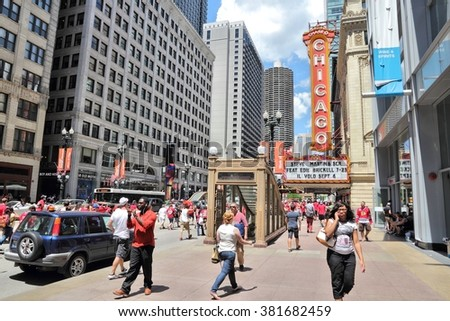 CHICAGO, USA - JUNE 28, 2013: People walk past Chicago Theatre in Chicago. Chicago Theatre was founded in 1921 and is a registered Chicago Landmark. - stock photo