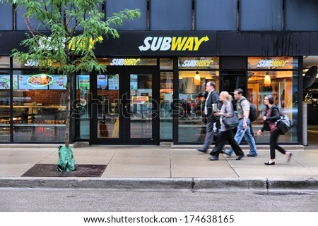 CHICAGO, USA - JUNE 26, 2013: People walk past Subway sandwich store in Chicago. Subway is one of fastest growing restaurant franchises with 39,747 restaurants in 101 countries. - stock photo