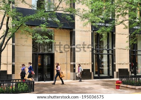CHICAGO, USA - JUNE 26, 2013: Shoppers walk by Giorgio Armani fashion store at Magnificent Mile in Chicago. The Magnificent Mile is one of most prestigious shopping districts in the United States. - stock photo