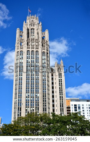 CHICAGO, USA - OCTOBER 6: Famous Tribune building in downtown of Chicago, Illinois, in October 6th, 2014.Chicago is the biggest city in North of USA.  - stock photo