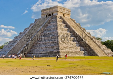 CHICHEN ITZA, MEXICO - DECEMBER 26: Tourists visiting Chichen Itza, one of the most visited archaeological site in Mexico on December 26, 2007. About  1.2 million tourists visit Mayan ruins every year - stock photo