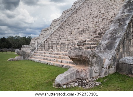 Chichen Itza pyramid stairs with snake head under a storm, in Riviera Maya, Mexico - stock photo