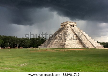 Chichen Itza pyramid with storm coming, Mexico - stock photo