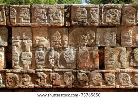 Chichen Itza Tzompantli the Wall of Skulls Mayan Yucatan Mexico - stock photo