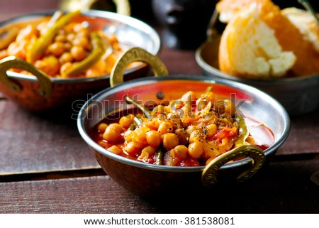 chick-pea stewed with haricot and a tomato on Lebanese in a copper vintage bowl. selective focus - stock photo