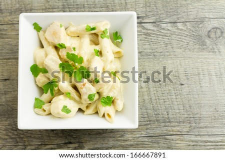 Chicken Aldredo garnished with flat leaf parsley, above - stock photo