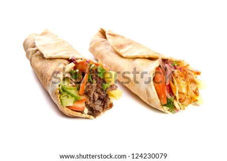 Chicken and beef kebaps on white - stock photo