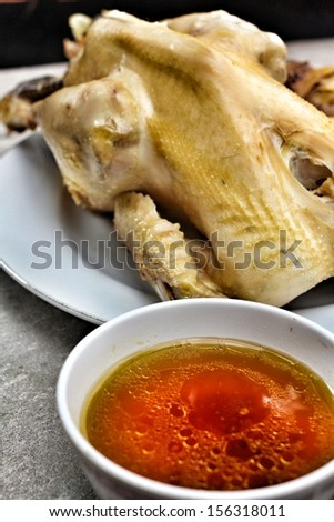 Chicken and herb soup chinese in pot - stock photo