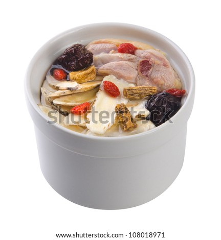 Chicken and herb soup in pot, Chinese food style. - stock photo