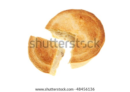 Chicken and mushroom pie with a section cut out - stock photo