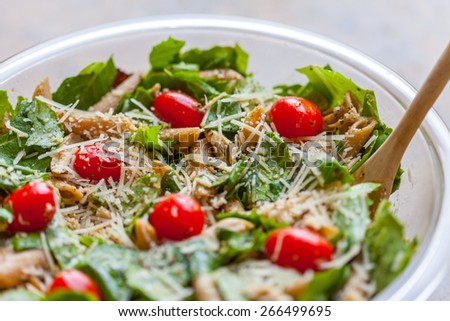 Chicken and pasta caesar salad - stock photo