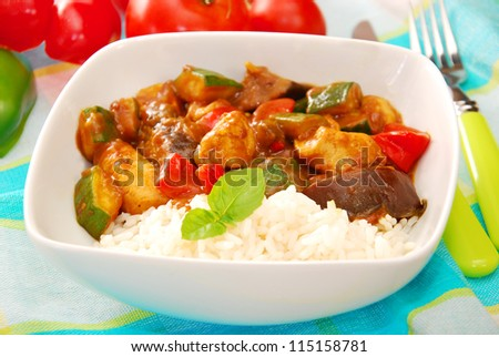 chicken and vegetables in curry sauce with rice for delicious dinner - stock photo