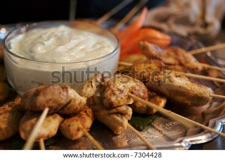 Chicken appetizer on serving platter - stock photo