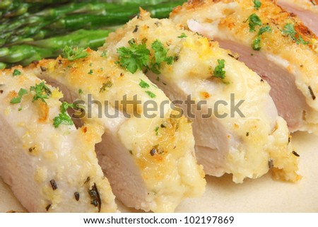 Chicken baked with cheese, lemon and herbs - stock photo