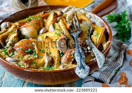 Chicken baked with pumpkin and cream - stock photo