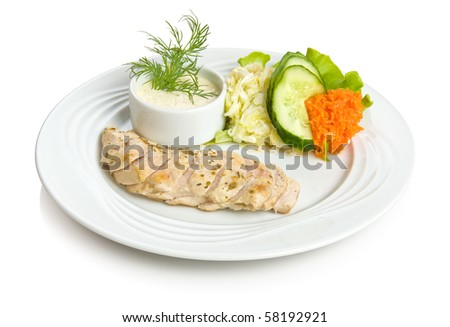 Chicken breast baked in wine with vegetable side dish. Isolated on white. - stock photo