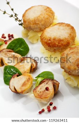 Chicken Breast Cutlet on Potato Mash with Mushrooms. Served with Fresh Basil Leaf and Thyme - stock photo