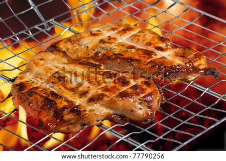 chicken breast grilled with flames - stock photo