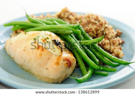 chicken breast stuffed with goat cheese and arugula, with french beans ...