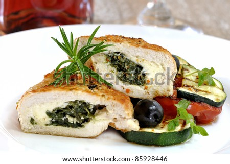 chicken breast stuffed with spinach and gorgonzola - stock photo