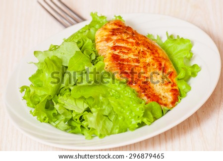 chicken breast with fresh salad - stock photo