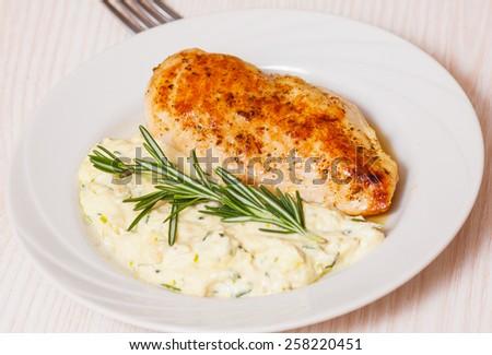 chicken breast with garnish - stock photo