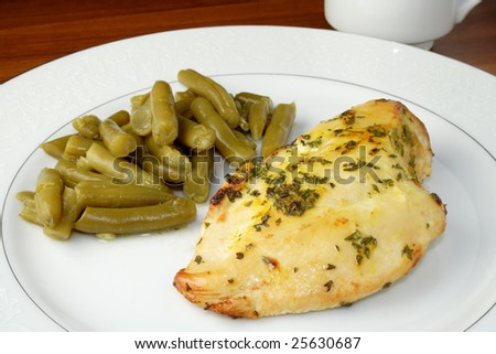 Chicken breast with green beans on plate