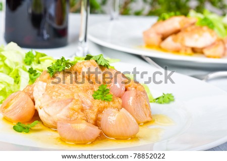 Chicken breast with onion vinaigrette and salad. - stock photo