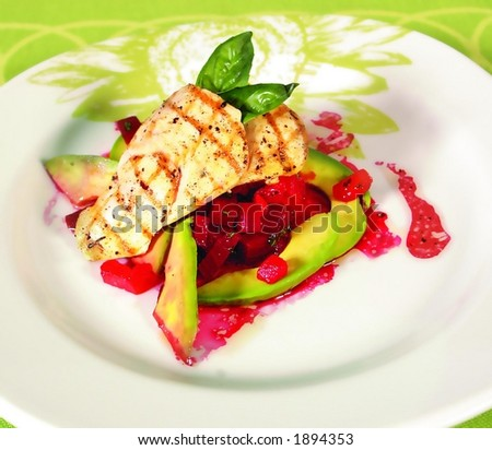 Chicken breast with red beet sauce and avocados - stock photo