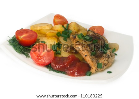 Chicken breast with roasted potatoes and fresh tomatoes. Isolated.