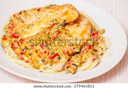 Chicken Breast with spaghetti and vegetable sauce - stock photo