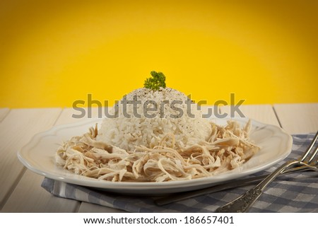 Chicken Breast with Turkish Pilav Rice with yellow background - stock photo