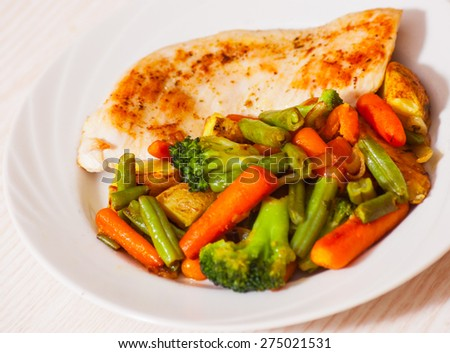 Chicken breast with vegetables - stock photo