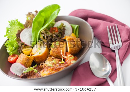 Chicken breast wrapped with vegetables and hash brown in clean food concept - stock photo