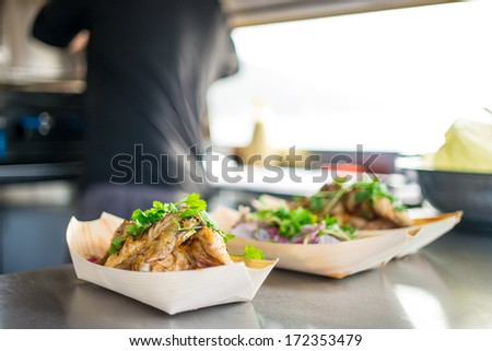 Chicken breasts being served to the window in the outdoor fast food - stock photo